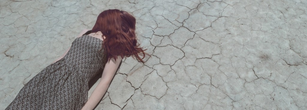Girl face down on a lake bed. Downsizing in a downturn hangs your people out to dry